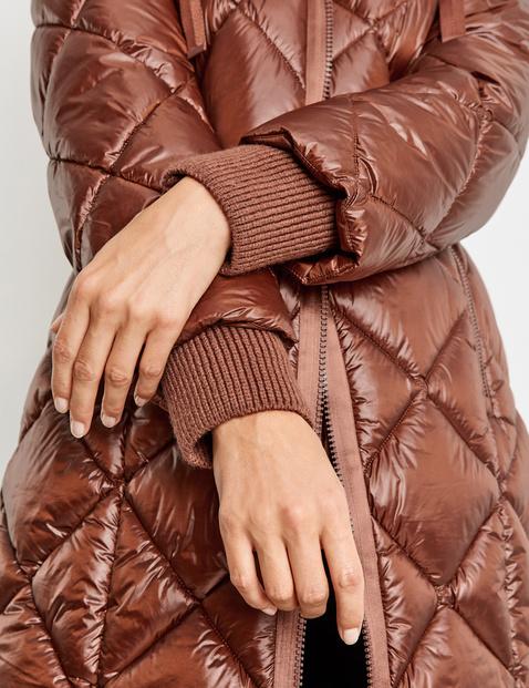 Coat with diamond quilting