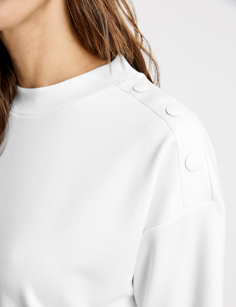 3/4-sleeve top with decorative buttons