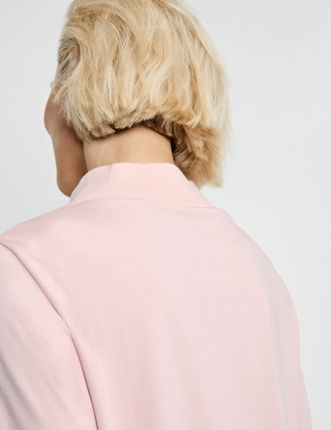 Top with a stand-up collar