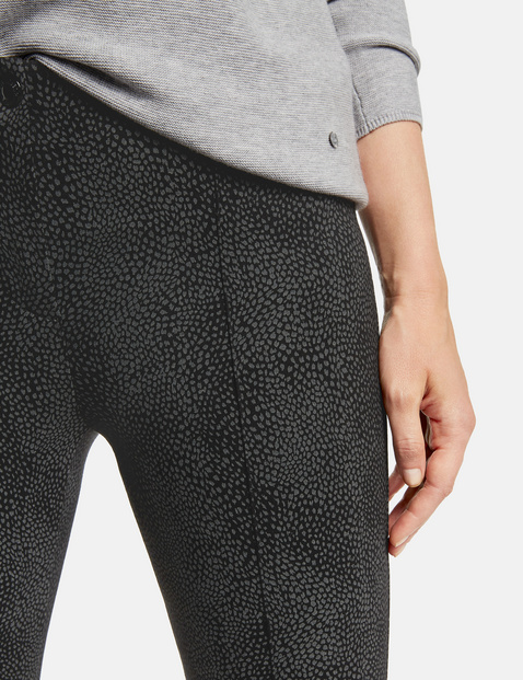 Trousers with a snakeskin pattern