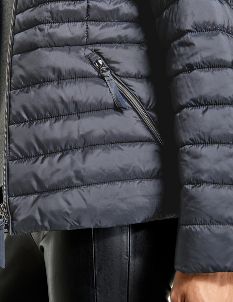 Quilted jacket with a stand-up collar