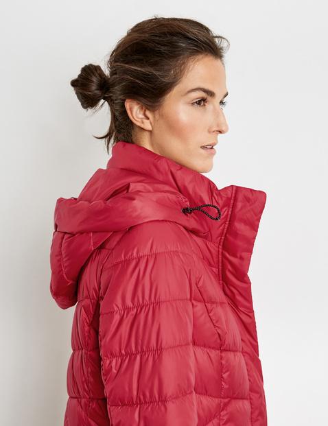 Coat with zigzag quilting