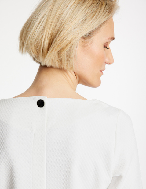 3/4-sleeve top with a waffle texture